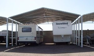 A Metal RV Cover With No Side Panels. This RV Carport Is Part Of A  Large Scale RV Storage Operation, Where A Series Of RV Covers Are Installed.