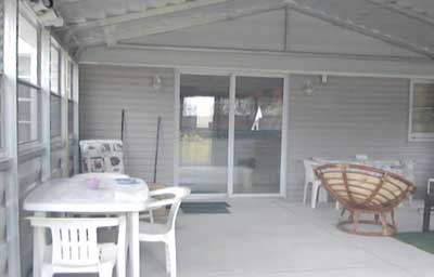 Steel patio room access to main home