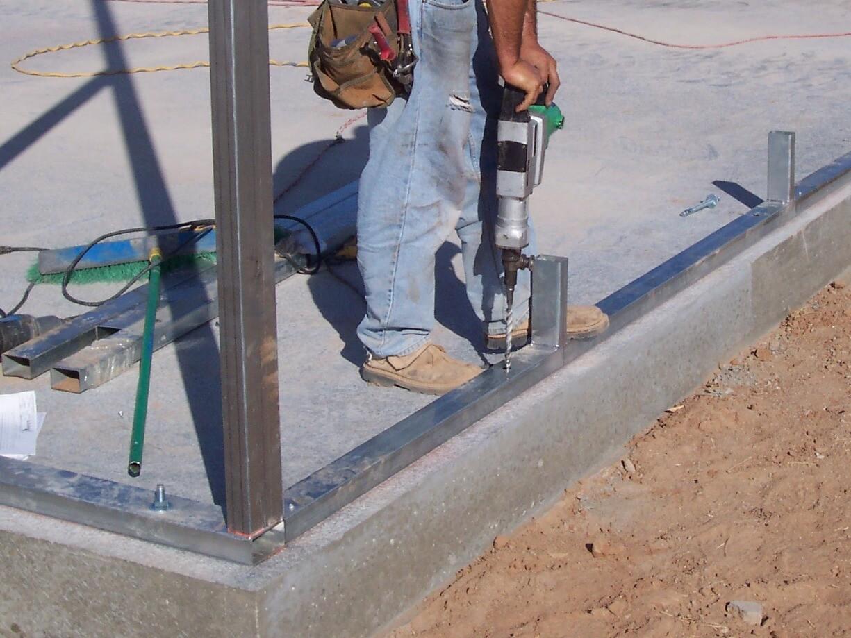 Attach base rails to concrete