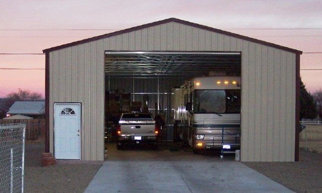 Metal rv garage lots of extra space for Rv garage plans with living space