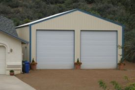 STEEL GARAGE NEXT TO HOUSE